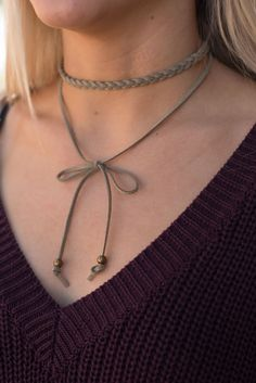 Braided bow choker necklace. This trendy yet affordable chocker necklace has a boho vibe to it making it a must have this Fall and Winter! The perfect added touch to any of our Piko tops!
