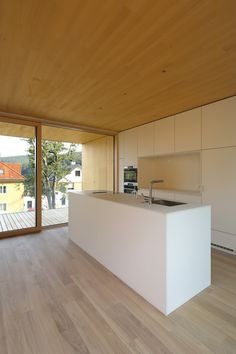 Image 13 of 28 from gallery of L House / Juri Troy Architects. Photograph by Juri Troy Wooden Facade, Wooden Slats, Wooden Room, Geothermal Energy, Floor To Ceiling Windows, Interior Design Kitchen, Modern Architecture, Outdoor Spaces, Furniture Design