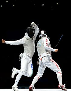 Andrea Baldini (L) of Italy competes against Kenta Chida (R) of Japan in the gold medal match of the Men's Foil Team Fencing finals on Day 9 of the London 2012 Olympic Games at ExCeL on August 5, 2012 in London, England.