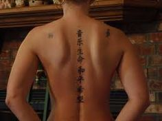 """Back Tattoo Ideas for Women: Chinese Tattoo """"Music is life, peace, and hope."""" (via Tattoo for christmas   Flickr - Photo Sharing!) More Tattoo Ideas for Women"""