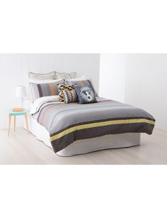 A polished palette of neutral charcoals, moderate taupes and bright pastels bring this classic chevron patterned duvet cover set to  life.