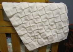 Make this easy basketweave baby blanket with Lion Brand Pound of Love! Free knitting pattern by Carole Barenys