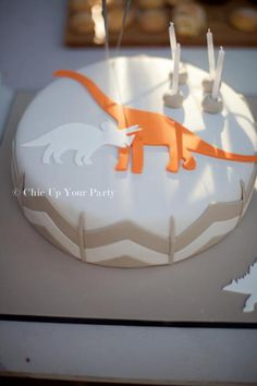 dinosaur party birthday cake [Very very chic - I kind of like although I think the other cakes are more kid friendly]