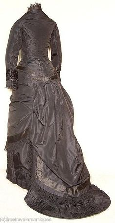 1880's Mourning Gown, back view. Images courtesy of time travelers antiques.