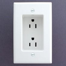 Recessed outlets so that the plugs don't stick out from the wall. Allows furniture to be flat against the wall
