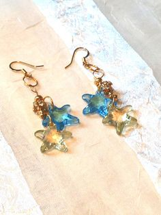 Sea Star Earrings in Blue & Green With Bling by NorthCoastCottage, These cheerful summery earrings are made of Swarovski ( goldplated findings and crystal-studded gold beads . Starfish Earrings, Star Jewelry, Star Earrings, Summer Of Love, Gold Beads, Jewelery, Blue Green, Jewelry Making, Siesta Key