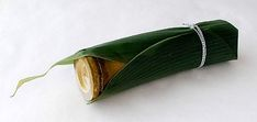 Two different kinds of natural bamboo are employed here: A section of a bamboo stem covered with a sasa (bamboo grass) leaf and a bamboo container. By Furyudo.