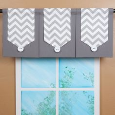@Overstock.com - Design Your Valance Chevron 3-Panel  - This decorative valance features our hot grey and white chevron banner. It is layered on a grey fabric panel with a black fabric on the back, making this valance reversible. A big white coconut button finishes the look.   http://www.overstock.com/Home-Garden/Design-Your-Valance-Chevron-3-Panel/7870059/product.html?CID=214117 $129.00