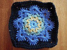 Woolly's Snowflake Square - see the colour combo used on http://kimsonksen.blogspot.com/2012/01/crochet-ole-cal-pt-i.html