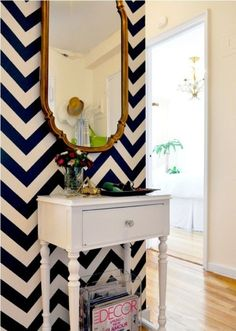 The Chevron black and white really pops with the white desk and gold mirror