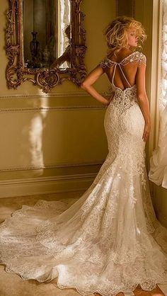 Beautiful Stunning tulle sweetheart neckline mermaid wedding dress with lace appliqués.