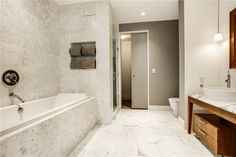 Contemporary Master Bathroom with frameless showerdoor, Pendant Light, complex marble tile floors, High ceiling, Flush