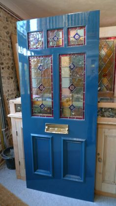 Beautiful blue Victorian style stained glass front door.