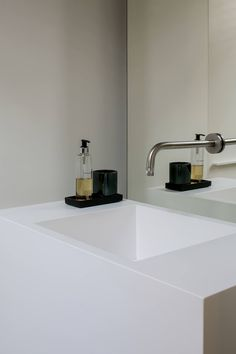 white sink with wall mounted faucet