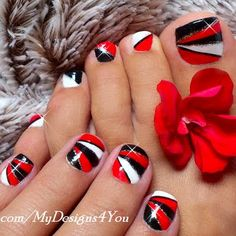 Red and black geometric shapes with glittered silver accent were used to create this mani. Watch the video for the quick tutorial on this mani.