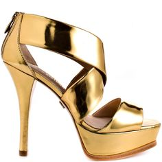 In this gorgeous style you'll attract more attention then the ball drop at midnight.  Pour La Victoire brings you a bright shiny gold metallic upper.  A simple overlapping strap design and single strap at the vamp show off the 1 1/2 inch platform and 4 1/2 inch stiletto heel.