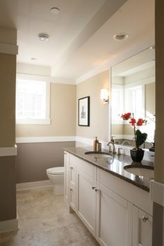 Sherwin Williams' ProMar 200 Zero VOC line. In the master bath, 7527 - Nantucket Dune was used above the wainscot, and 7635 - Palisade was used below