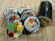 Kimbap. Not sushi. This is a Korean dish made with a sheet of dried seaweed, filled with rice, meat, egg, and veggies, then rolled up and cut into thin slices. Go try it!