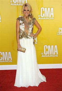 Carrie Underwood arrives at the 46th annual Country Music Awards at the Bridgestone Arena in Nashville on Nov. 1, 2012. See more stars at the 2012 CMA Awards on Wonderwall: http://on-msn.com/TphRJA