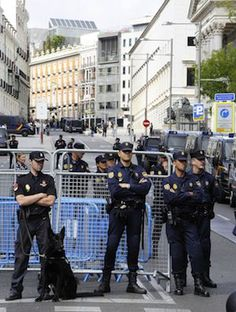 """OCCUPY CONGRESS: Policemen stand guard in front of Spain's parliament during a protest dubbed """"Occupy Congress"""" by Spain's """"indignant"""" protesters to decry an economic crisis they say has """"kidnapped"""" democracy in Madrid. (AFP)"""