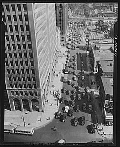 Detroit, Michigan. Typical Detroit traffic scene at 5:30 taken from the Fisher Building with the General Motors Building at the left, c. 1942