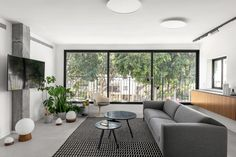 BZ Apartment Is a Tel Aviv Getaway for a Family on the Weekends - Design Milk Decor, Living Room Tiles, House Design, Green Storage Cabinets, Contemporary Interior, Apartment, Design Milk, Home Decor, Green House Design