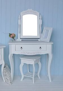 mostly white - I have my Grandmother's antique dressing table. Painted it white for Peri.