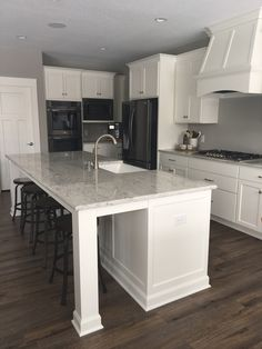 gray kitchen designs countertops this white kitchen is classic yet modern and features crisp cabinetry an oversized black stainless kitchenaid appliances cabinets craftsman