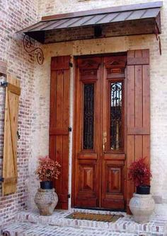 Here's a New Orleans style door.  Love the wood with iron style.  front door. doors. New Orleans. home remodel. custom doors.