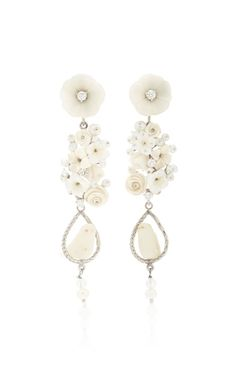 Of Rare Origin's 'Nester' earrings are a playful pairing of elegance and whimsy. Cast from 18K yellow gold vermeil, this romantic style is strung with a medley of natural and composite bone, pearl, tagua, and diamond, and finished with a carved bird set atop a gold perch. Showcase yours with pulled-back hair.
