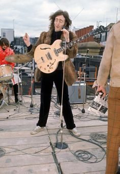 John singing during The Beatles' final public performance, on the roof of the Apple offices - The Beatles