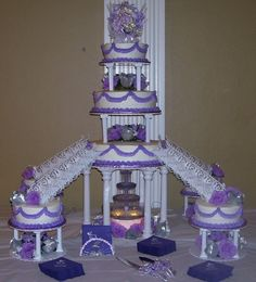 Four stairway all buttercream quinceanera cake.  I do a lot of quince cakes  I must say girls like the stairways.  I took the picture before I added the  quince girls and escorts