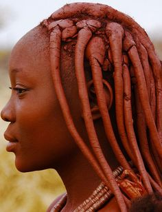 The Himba women of Namibia-They put beautiful red clay in their hair. More photos at the link!