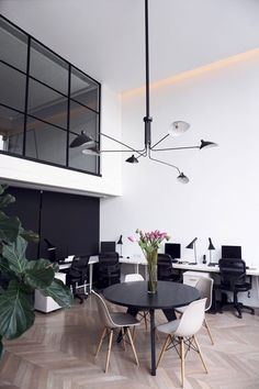 Indonesian architecture and interior firm ATT Architects has transformed a loft space in Jakarta into a pared-back office, which draws inspiration from Scandinavian design.