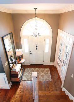 Love the french doors off of the foyer...would love to do this. Paint Color — Sherwin Williams Virtual Taupe