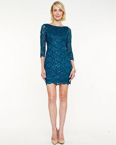 A fitted cut-out cocktail dress is crafted from a shimmering lace for a stunning cocktail look.