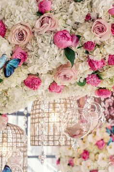 Amazing flowers with baubles and butterflies.  WedLuxe  Photography by: Leanne Pedersen Photographers