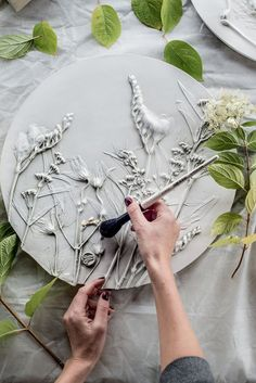 Botanical Plaster Artwork – Press branches, leaves, and other objects found in nature (rocks and pods work well) into the clay. Use clay tools if needed to make deeper indentions. Plaster Crafts, Plaster Art, Concrete Crafts, Clay Crafts, Arts And Crafts, Slab Pottery, Ceramic Pottery, Pottery Art, Ceramic Art