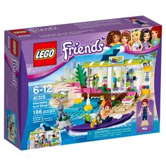 The LEGO® Friends Heartlake Surf Shop includes a cash register and all kinds of holiday supplies. Hire a range of watersports equipment, from surfboards, a kayak and paddle to flippers and a waterproof camera. Outside there's a beach area with sun lounger and shower, a jetty with buoys and a rock, which is home to a seal figure. Includes a mini-doll figure.<br>• Includes a Mia mini-doll figure in a wetsuit, plus Velvet the seal figure<br>• Feat...