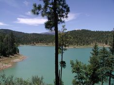 View of Grindstone Lake and Sierra Blanca from trail.
