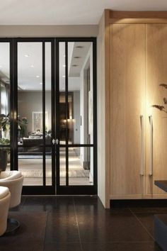 The Bod'or collection constitutes a range of unique doors, from basic to iconic, completed with a choice from various opening and closing systems, plus the right trimmings, and high-quality locks and hinges. Trap Door, Interior And Exterior, Interior Design, Hardwood Floors, Flooring, Unique Doors, Ceiling Height, Ceiling Design, Office Interiors