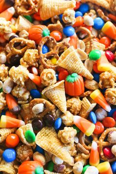 Halloween Sweet & Salty Snack Mix Halloween has always been one of my favorite holidays. I can remember eagerly reading Halloween-themed books and planning out my costume as October approached. I later learned that some people consider it to be an Halloween Desserts, Halloween Snack Mix Recipe, Halloween Food For Party, Halloween Cupcakes, Fall Halloween, Thanksgiving Trail Mix Recipe, Halloween Treats For School, Easy Halloween Snacks, Halloween Popcorn