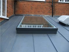 Single ply membrane roof, (sarnafil or similar) with applied decor strips to mimic a standing seam metal roof. House Extension Plans, Roof Extension, Extension Ideas, Zinc Roof, Metal Roof, Roof Window, Ceiling Windows, Porch Flat Roof, Front Porch