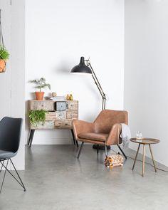 Een hippe Scandinavische setting helemaal van nu! Deze prachtige lederen fauteuil is de basis voor je interieur.