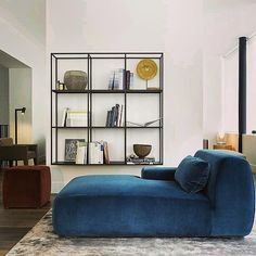 Casual chic contemporary living space by #Meridiani collection featuring #Norton chaise longue, #Hardy wall unit, #Charlot ottoman, and #Lalit rug.   Discover #Meridiani contemporary selections at MOIE.