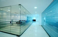 APOLO 14,000 M2 SHOWROOM | BT Arquitectos | Archinect Frosted Glass Sticker, Frosted Glass Design, Office Graphics, Startup Office, Glass Office, Corporate Office Design, Business Furniture, Space Architecture, Window Film