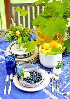 Use seasonal fruits, veggies and plants for a garden inspired summer tabletop.