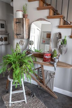 Build off the old, rustic look of an ironing board with accessories and plants