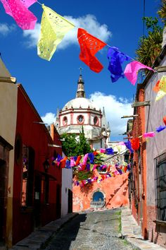 The papel picados flap in the breeze along Aldama in San Miguel de Allende. Photo by David Lansing.
