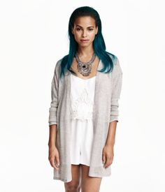 Cardigan in a loose, fine knit with long sleeves and no buttons.